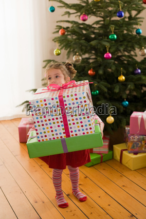 a girl holding a present