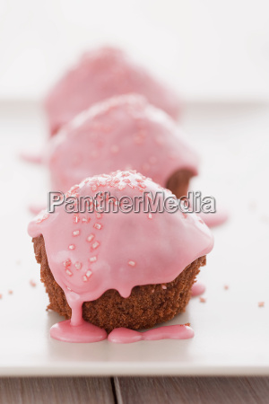 cakes covered in pink icing