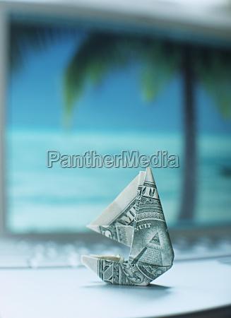 dollar folded in shape of sailboat