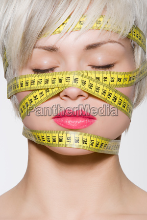 woman with tape measure around her