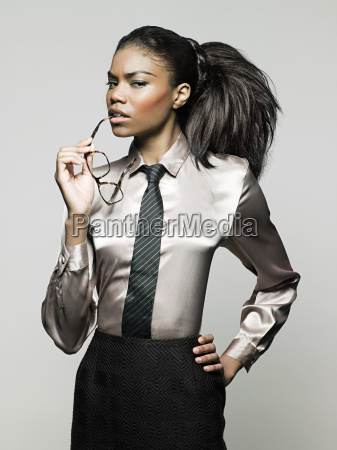 businesswoman holding glasses