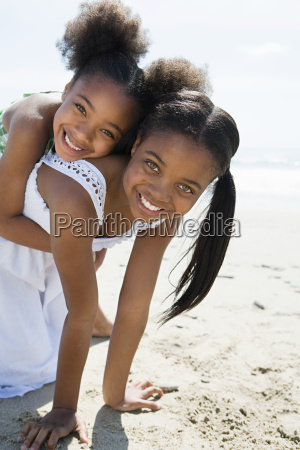 sisters playing on a beach
