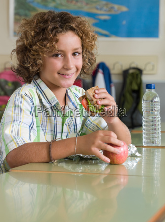boy with packed lunch