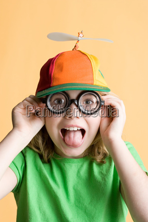 girl wearing silly glasses and hat