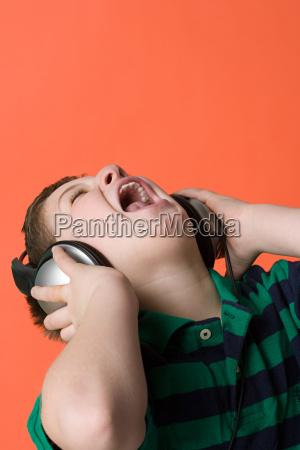 boy wearing headphones and singing