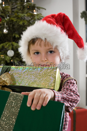 portrait of a boy holding presents