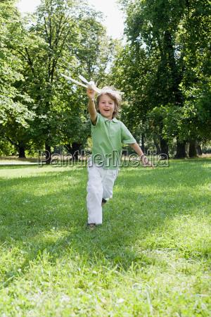 boy with a toy aeroplane