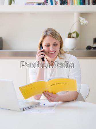 woman making an insurance claim on