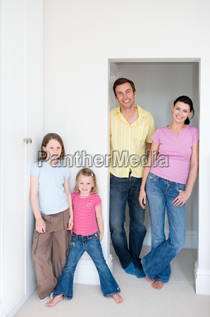 family standing in a doorway