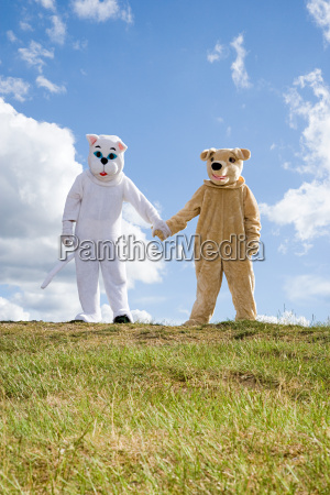 people in cat and dog costumes
