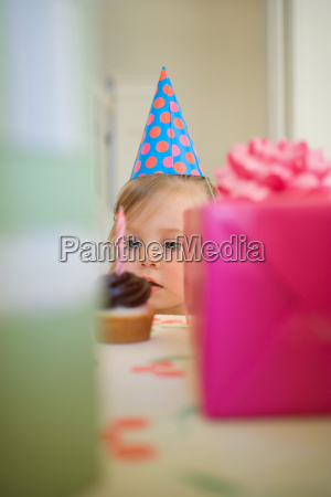 little girl looking at cake