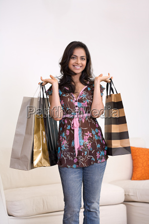 portrait of a woman holding shopping