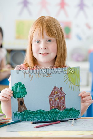 girl holding up a picture