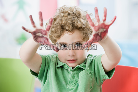 a boy with paint on his
