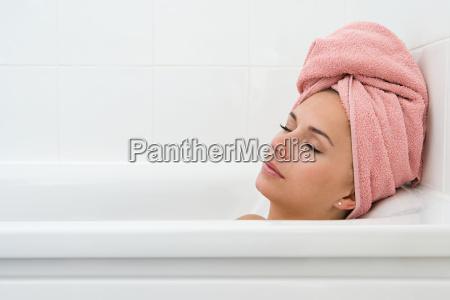 woman sleeping in bath