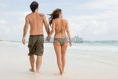 a couple walking along a beach
