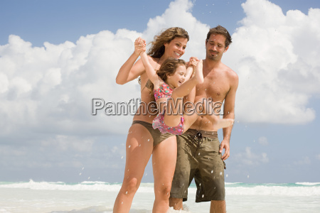 a family playing in the sea