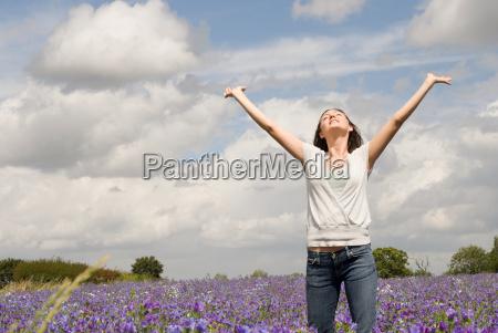 woman in field on flowers