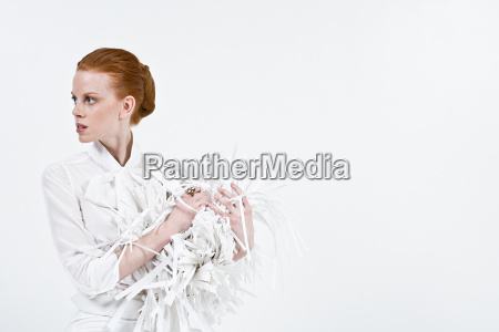 a businesswoman holding shredded paper