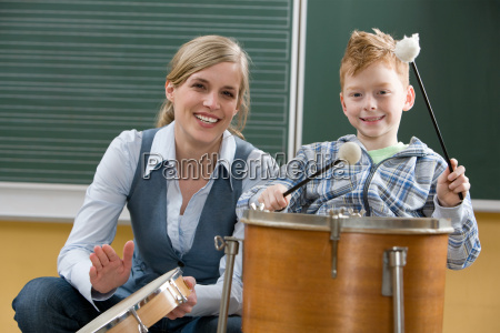 teacher and boy playing drum