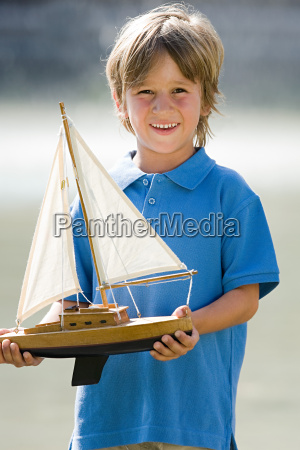 boy with a toy boat