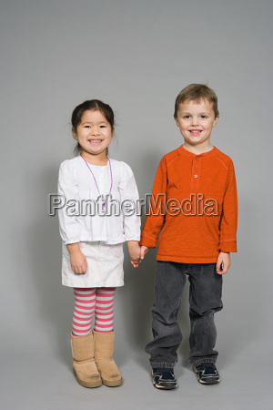 a boy and girl holding hands