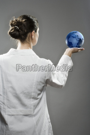 female scientist holding a globe