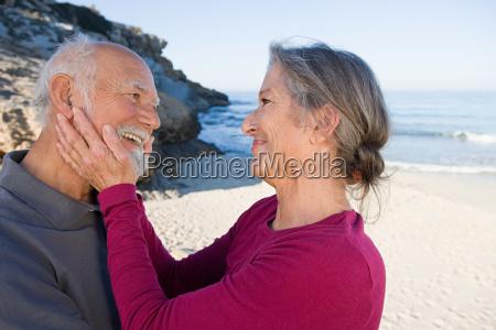 happy senior couple at beach