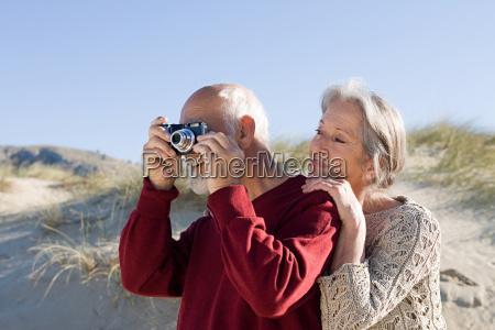 senior couple using a camera at