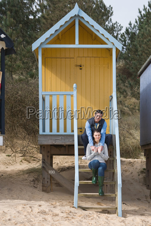 couple sitting on steps of a