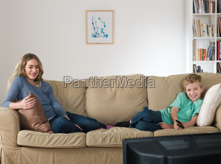 a mother and son watching tv