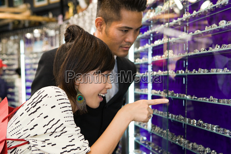 a man and woman looking at