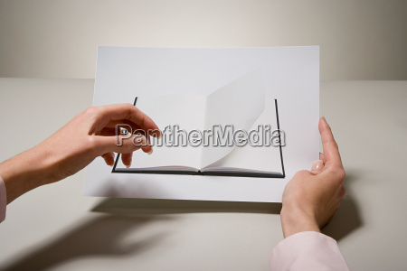 a woman holding a photograph of