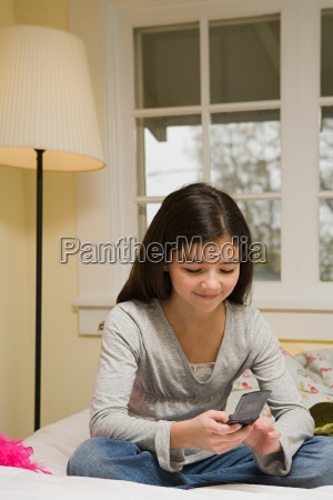 a girl texting on her cell