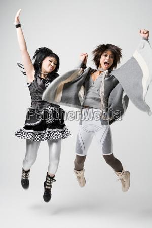 women jumping for joy