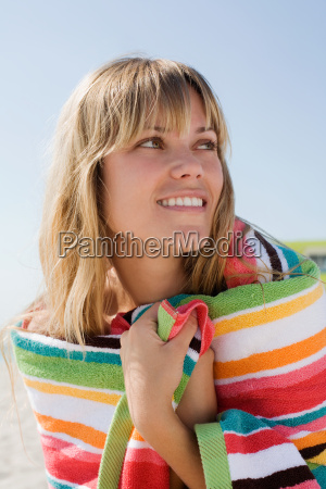 a young woman wearing a towel
