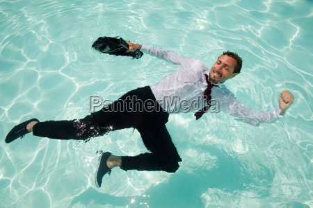businessman in swimming pool