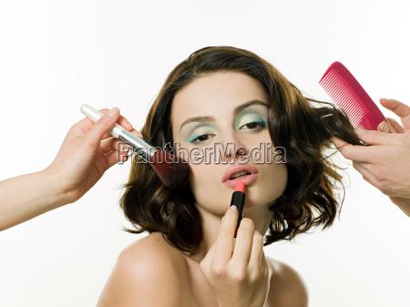 young woman having hair and makeup