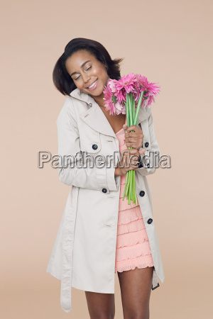 young woman with pink flowers