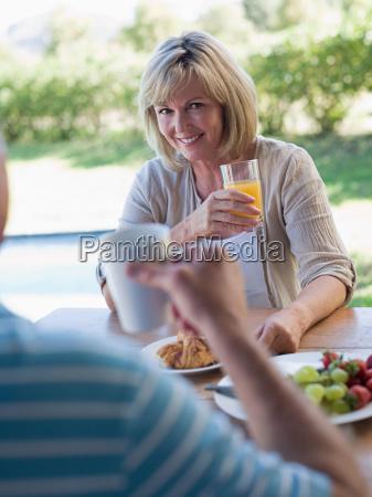 couple having breakfast in garden