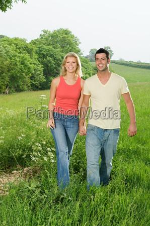 a couple walking through the countryside