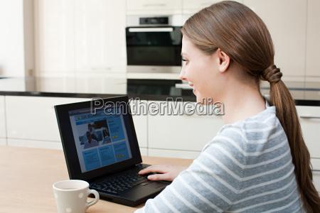 young woman looking at car insurance