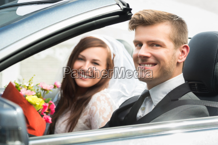 young just married couple in car