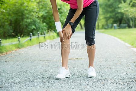 female jogger having pain in her
