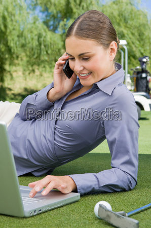 a businesswoman typing on a laptop