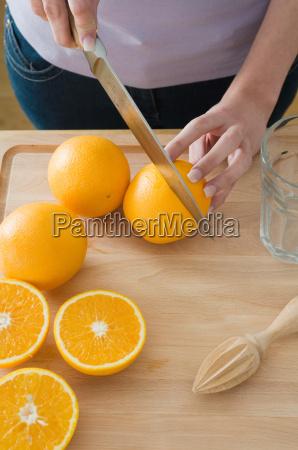 woman cutting oranges