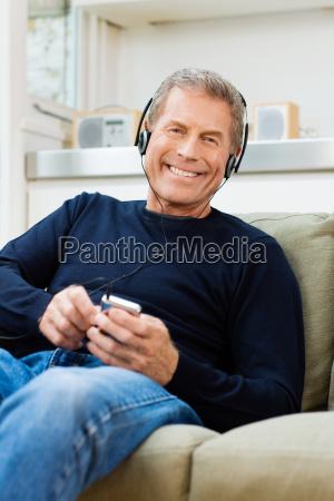portrait of a senior man listening