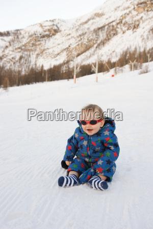 portrait of baby boy sitting in