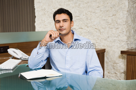 indian businessman in office