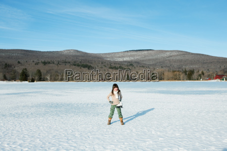 girl standing in snow with ice